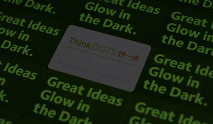 ThinkDots business card in the dark