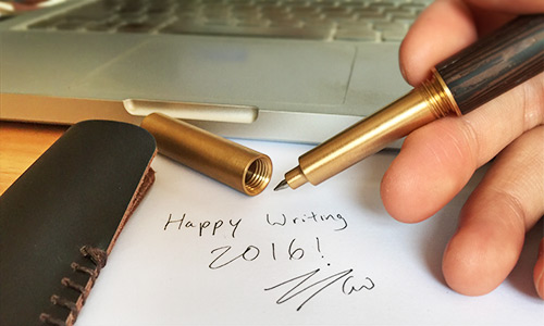 brass and wood pen writing